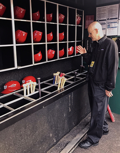 Msgr. Stephen J. Rossetti, a professor at The Catholic University of America and the chaplain for the Washington Nationals, blesses bats before a game during the 2019 season. (CNS photo/courtesy Msgr. Stephen J. Rossetti)
