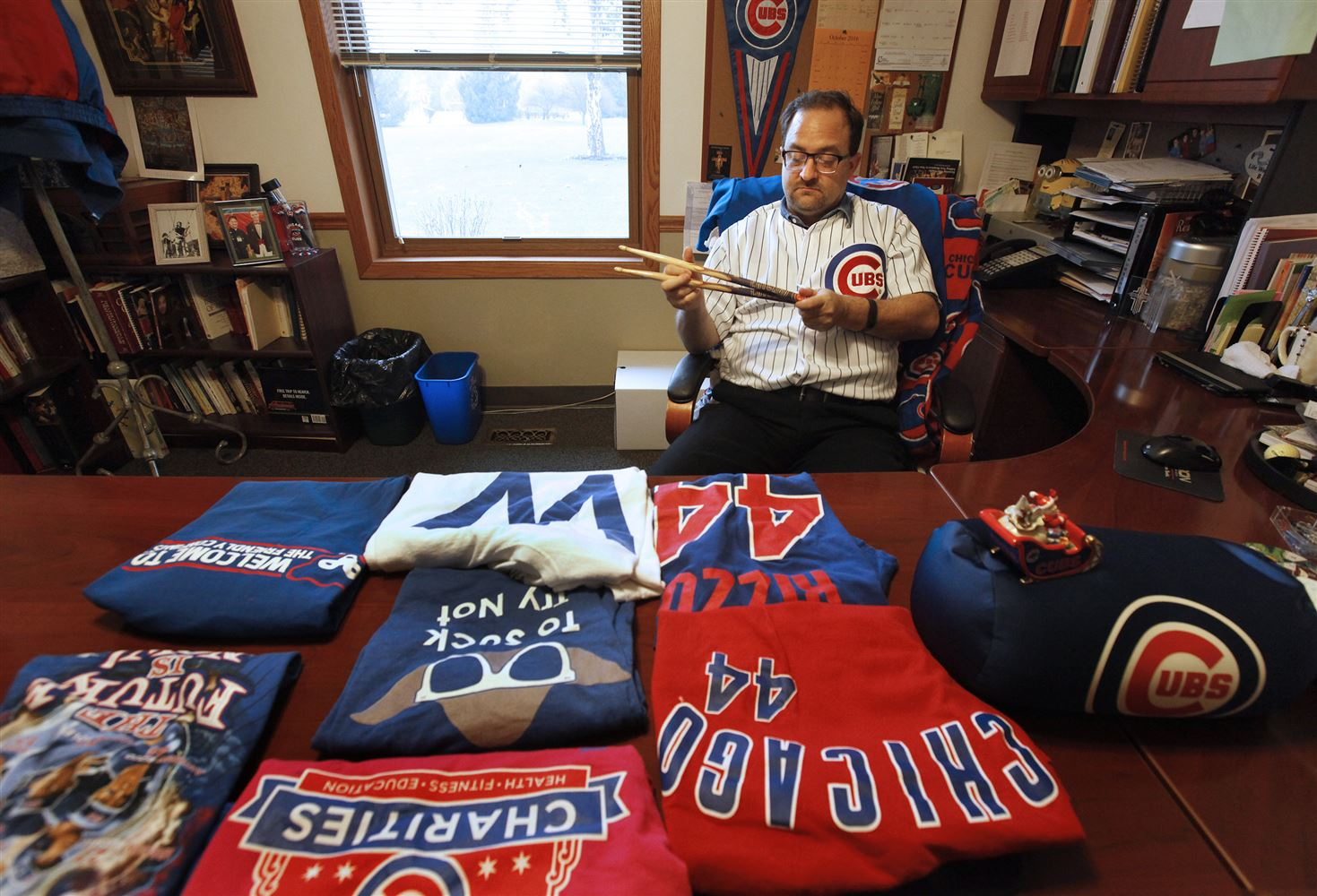 Father Michael Novick, Pastor Of St. Lawrence Ou0027Toole In Matteson, Holds  Cubs Drumsticks In His Office On Oct. 27. Cubs Shirts, Pennants And Other  ...
