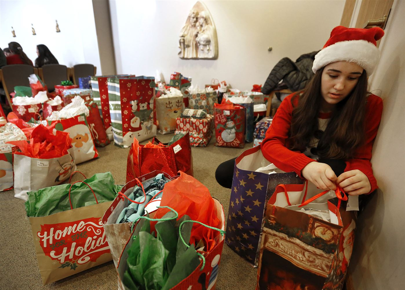 Catholic groups remember others during Christmas - Toy drives ...